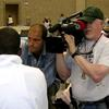 Talking to evacuees in the New Orleans Convention Center following Katrina.